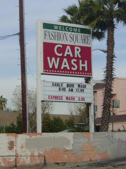 outdated car wash sign